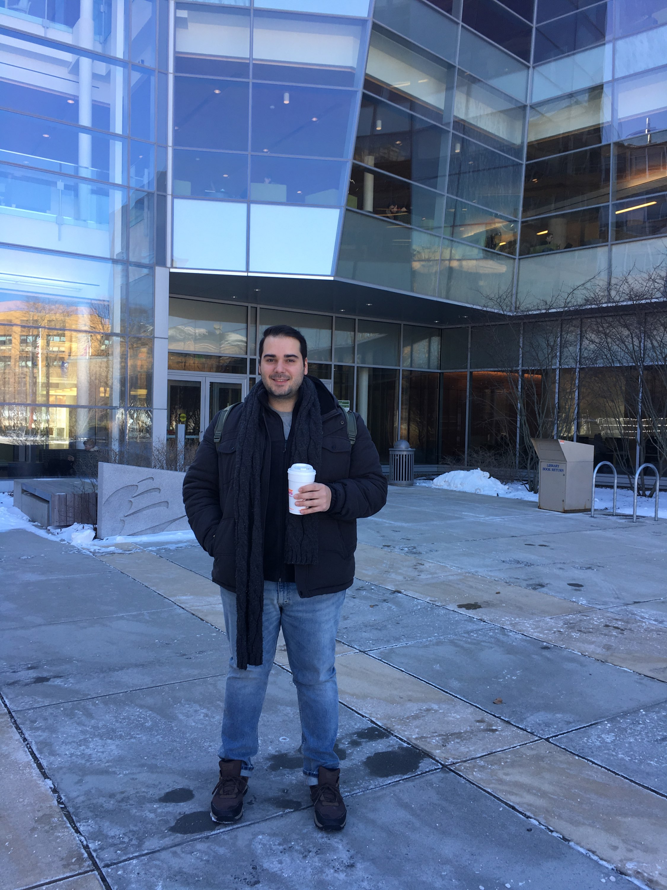 International student Sario Gregorio Freitas in front of the Berry Library