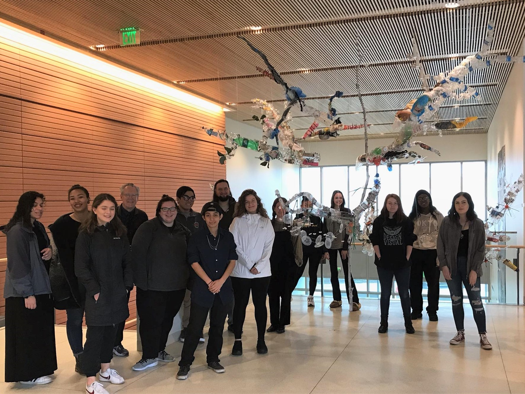 """Art students and Professor Ken Reker stand in front of their creation, """"Disconn…"""