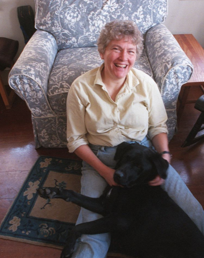 Sarah Gregory Smith sits with her guide dog