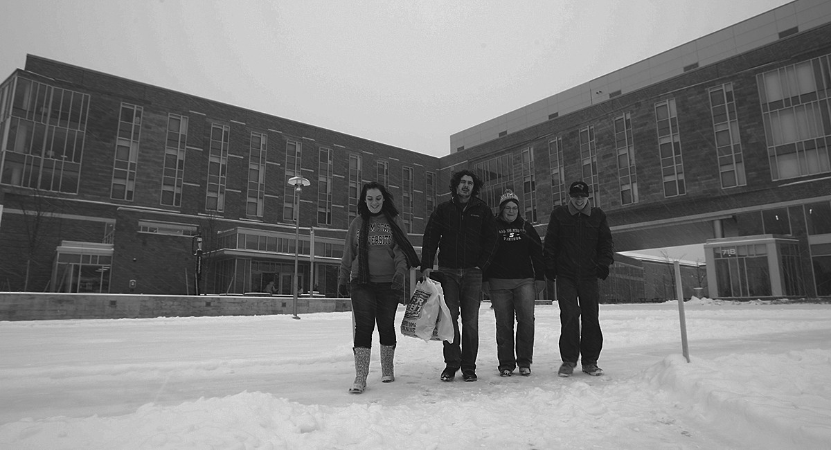 Salem State students walking in the snow on Central Campus