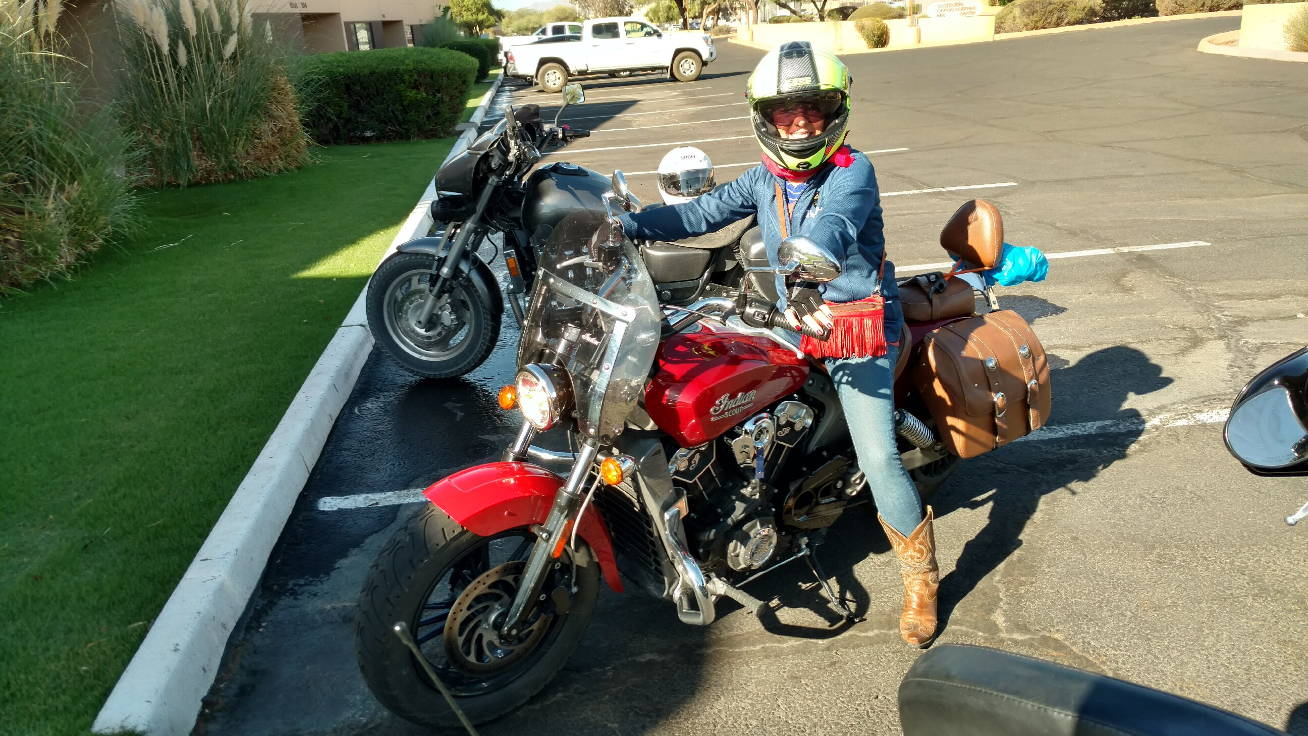 Laura Biddle riding her motorcycle