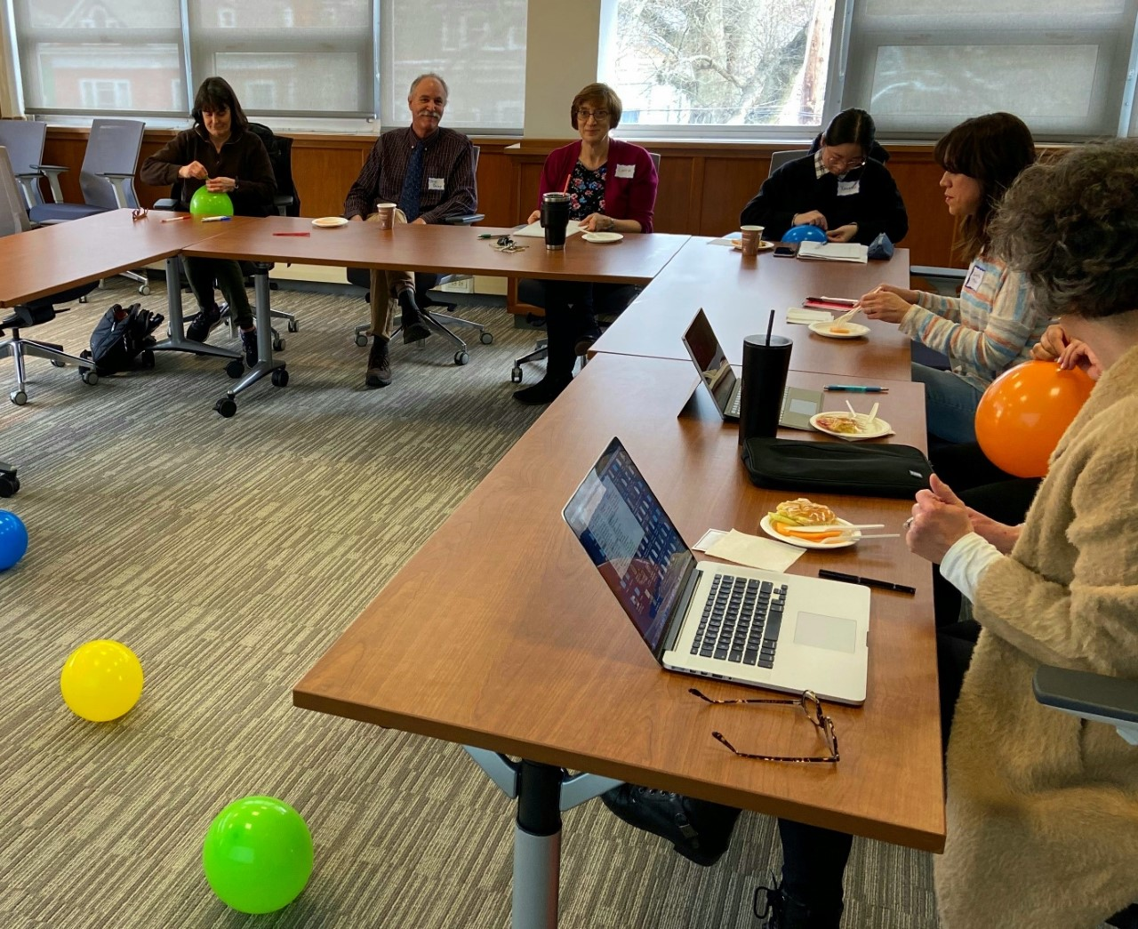 Faculty engaged in balloon exercise during workshop