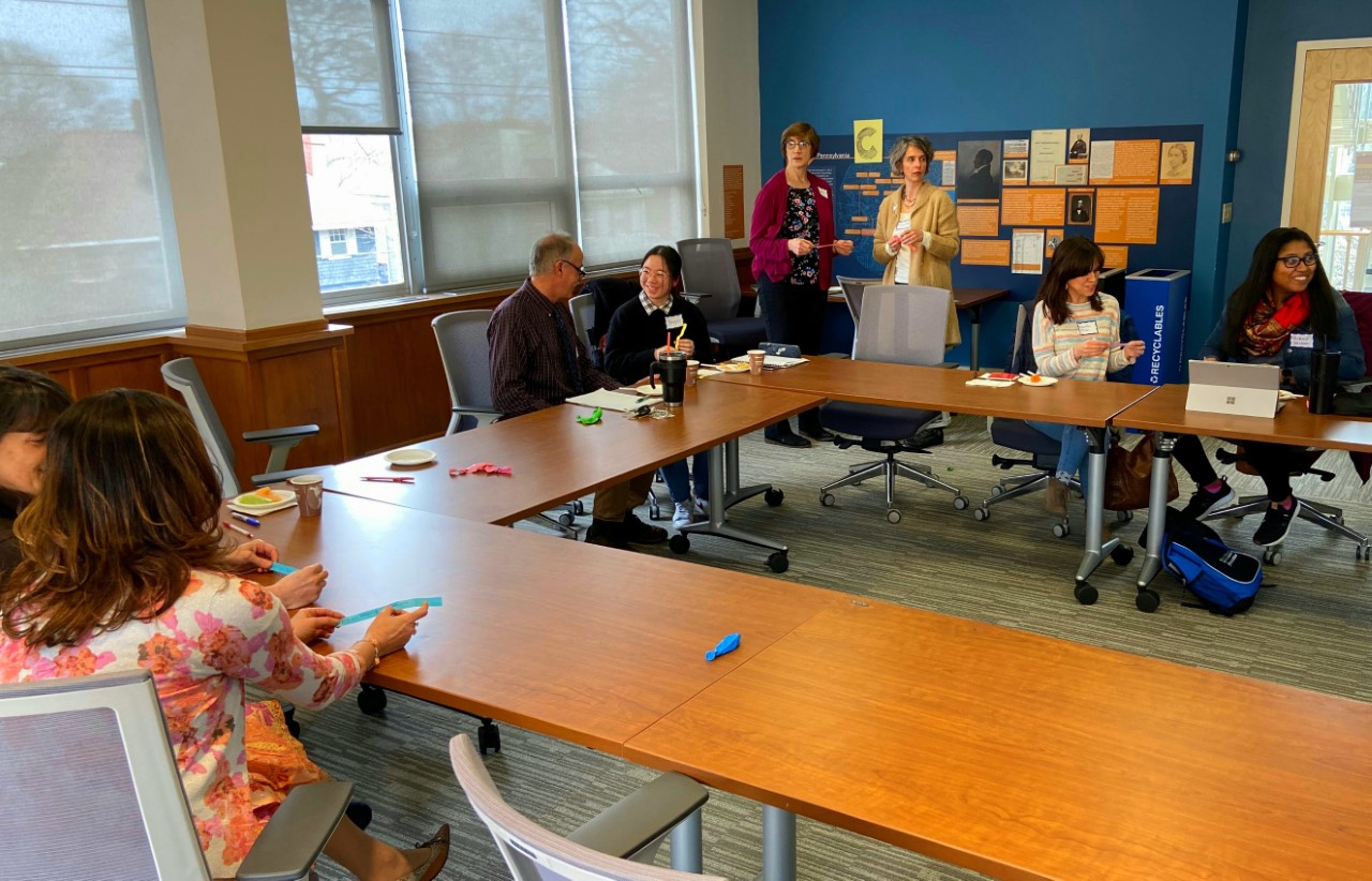 Faculty participating in ice breaker exercise to learn how to encourage student…