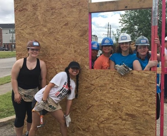 Community Service Initiative students building a home in Texas with Habitat