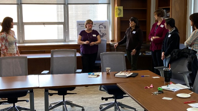 Faculty engaged in classroom game exercise to encourage participation