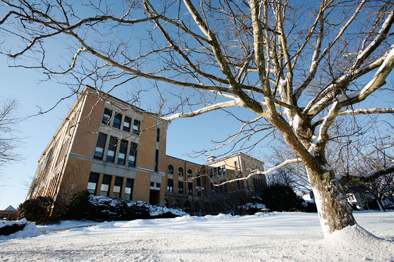 Sullivan Building during the winter with snow on the ground.