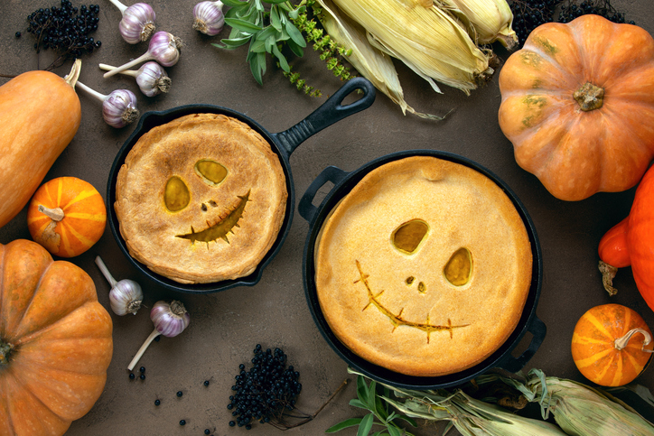Halloween kids party pumpkin pies baking concept, top down view on a cute coupl…
