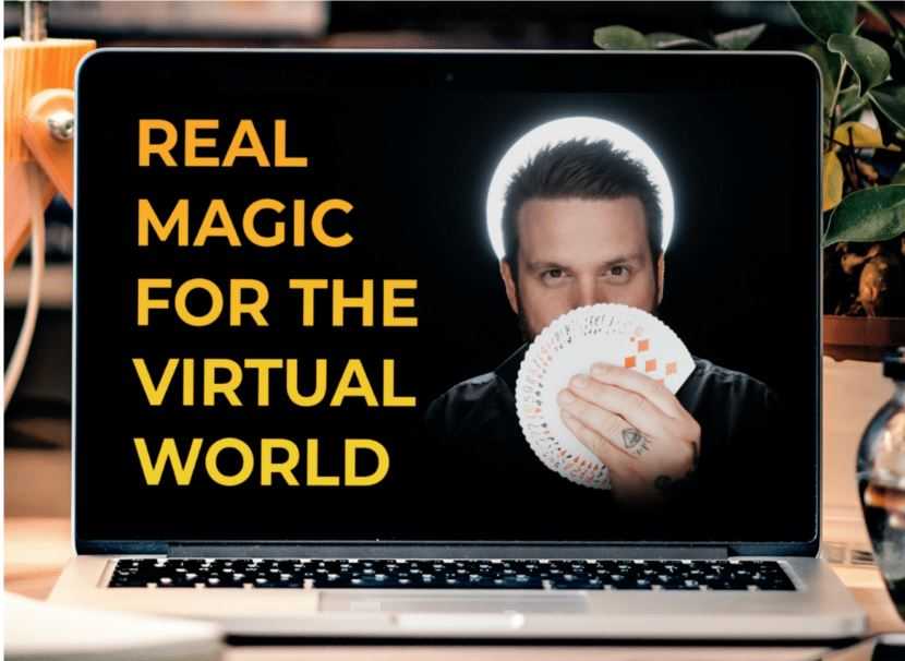 Magician holding cards - real magic for the real world