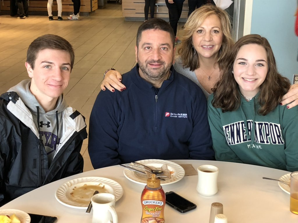 Student with family members in the dining hall