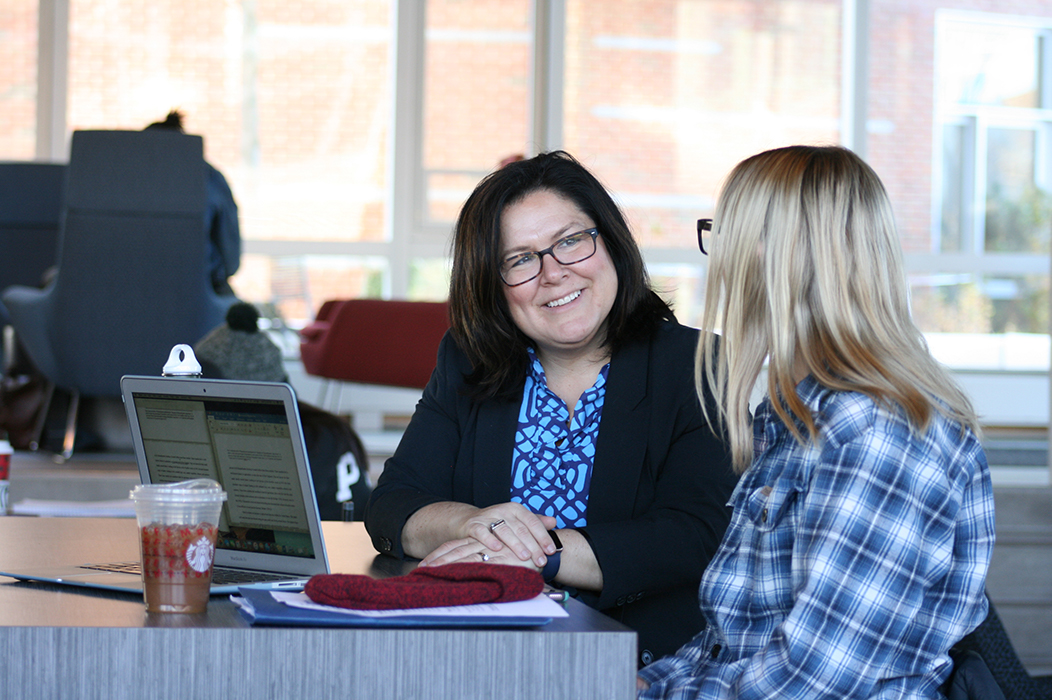 Cheryl Crounse chatting with Salem State student Caroline Robitaille '21 in the…