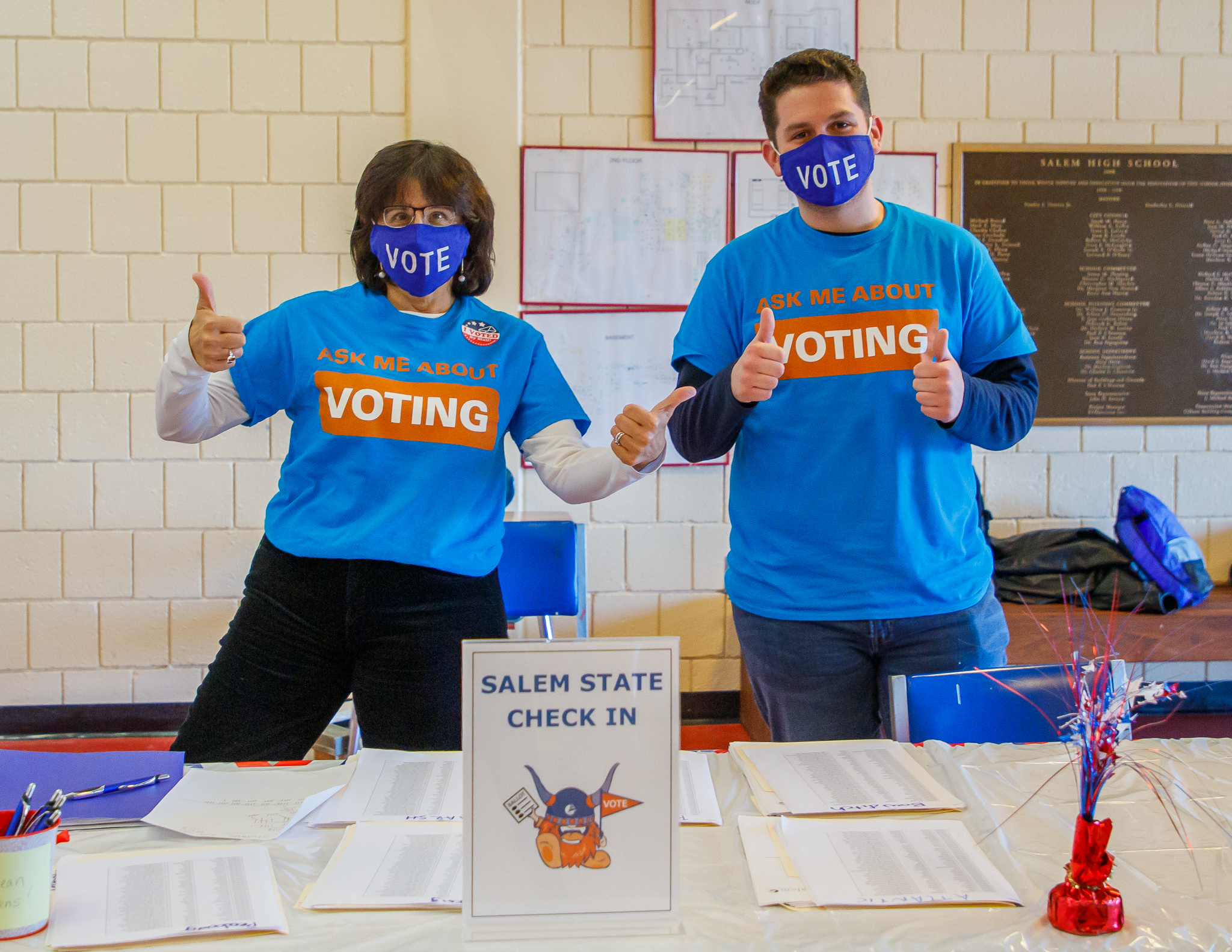 """Staff with the Salem State Center for Civic Engagement wear """"Vote"""" shirts and m…"""