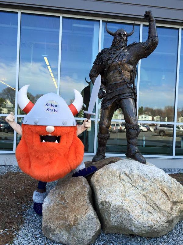 Superfan posed at Viking statue