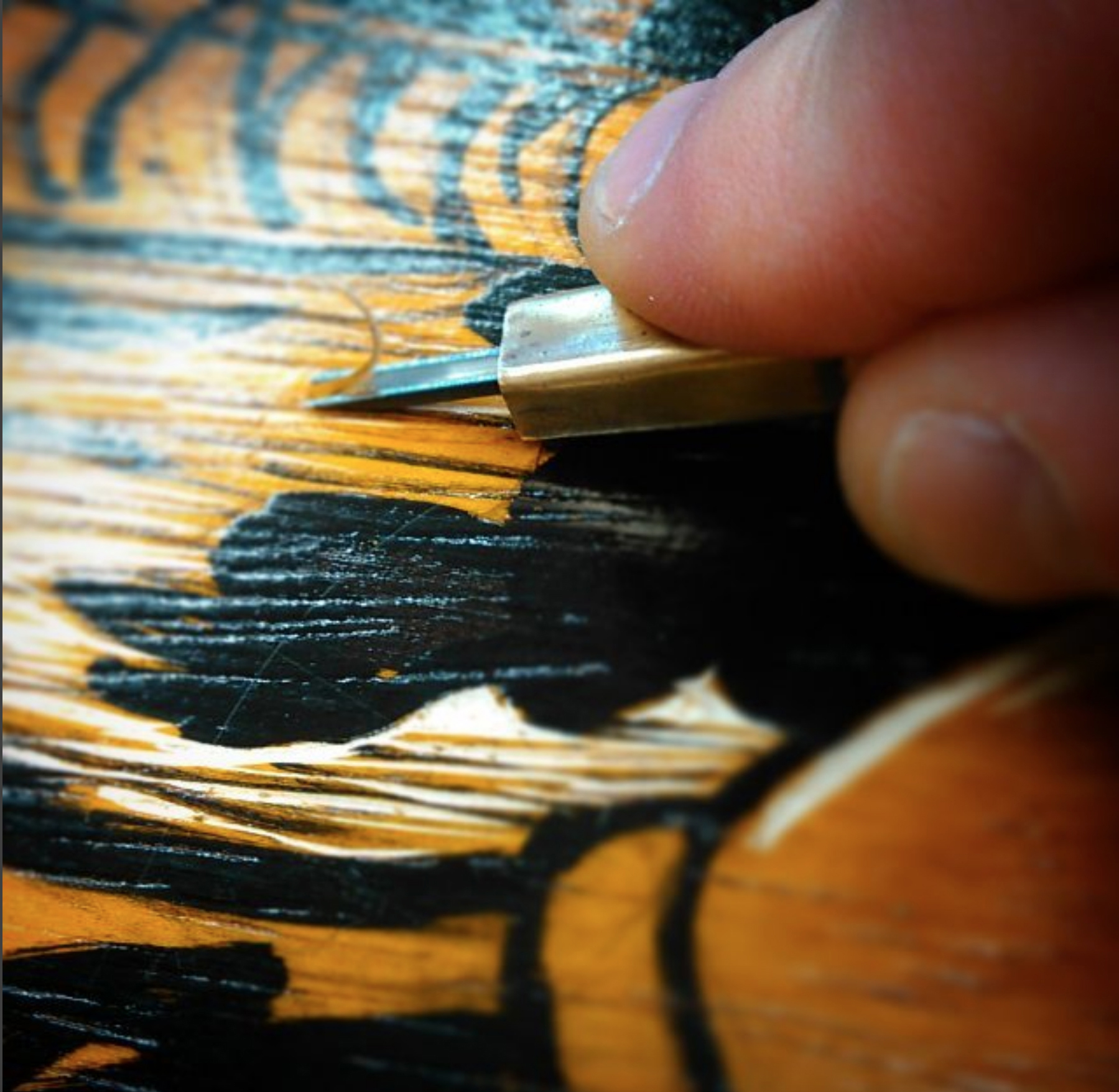 Professor Haig Demarjian prepares a woodcut for his latest series of work.