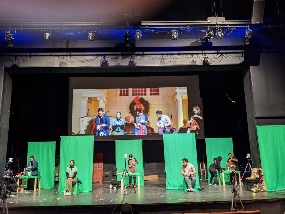 """Students perform in front of individual green screens for """"A Long Christmas Rid…"""
