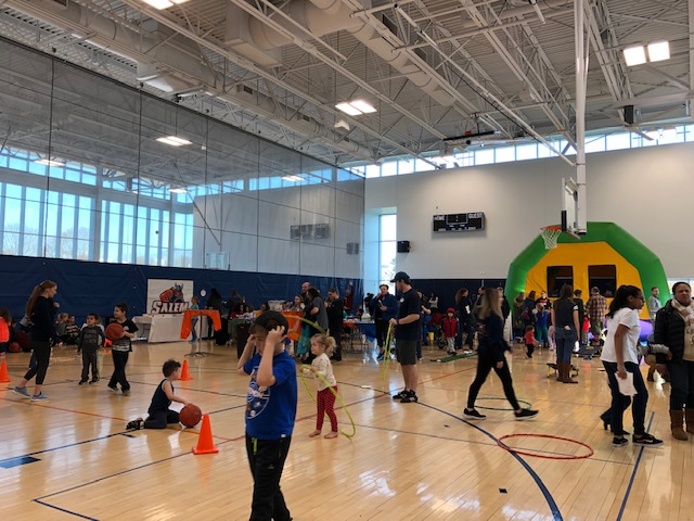 Crowd participating in Let's Move Salem games and activities