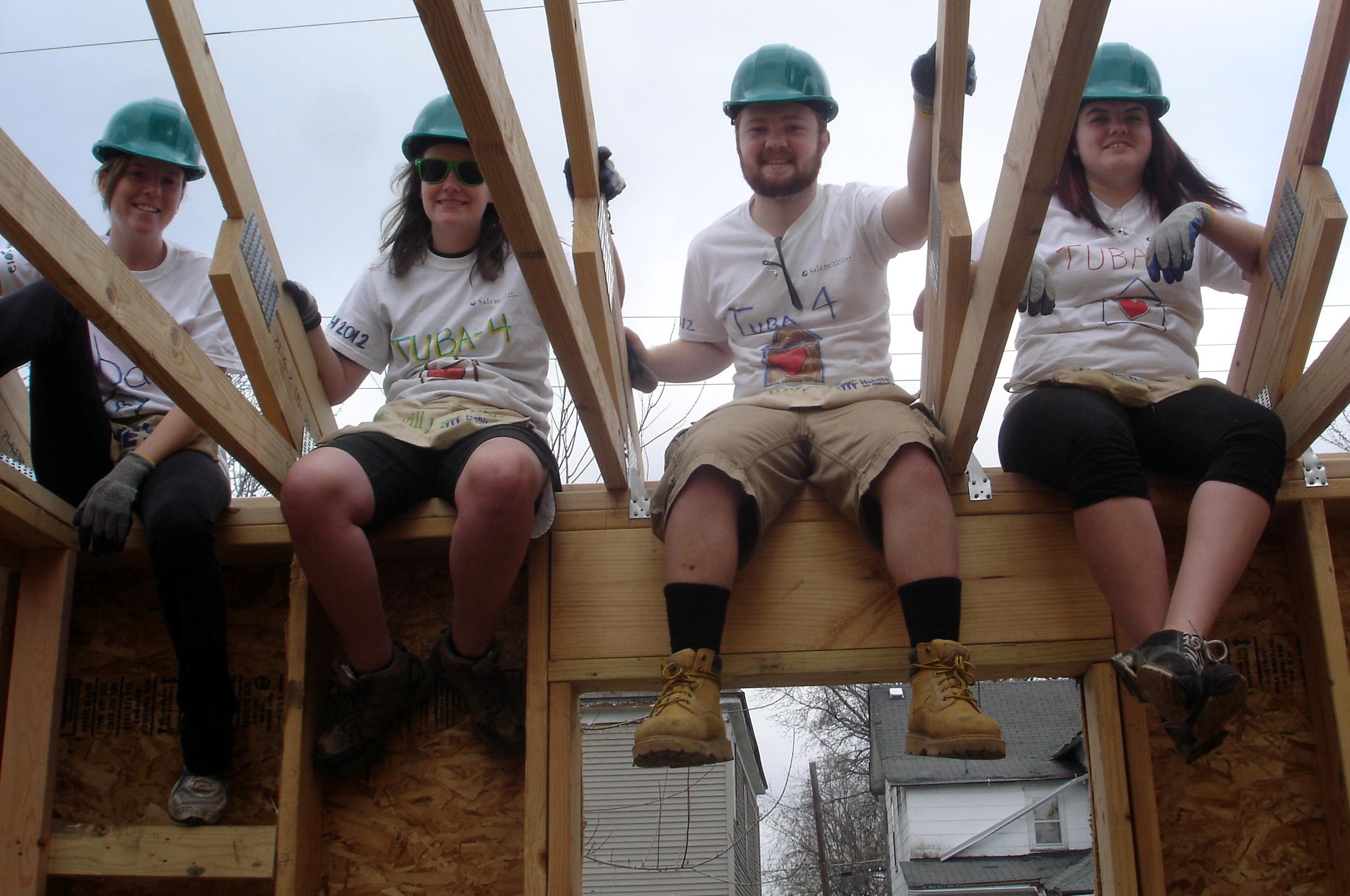 Photo of students building a house