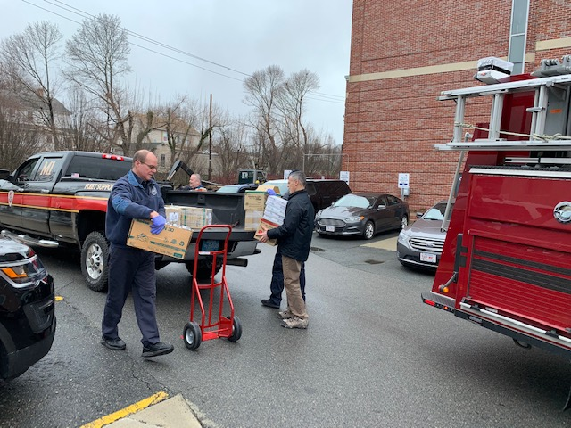PPE donations from Salem State are loaded up to be distributed