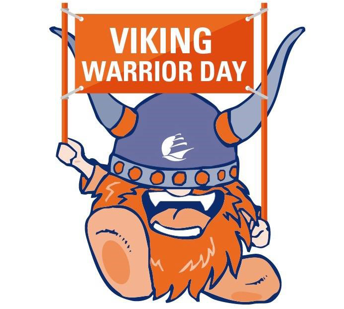 Superfan holding a Viking Warrior Day sign