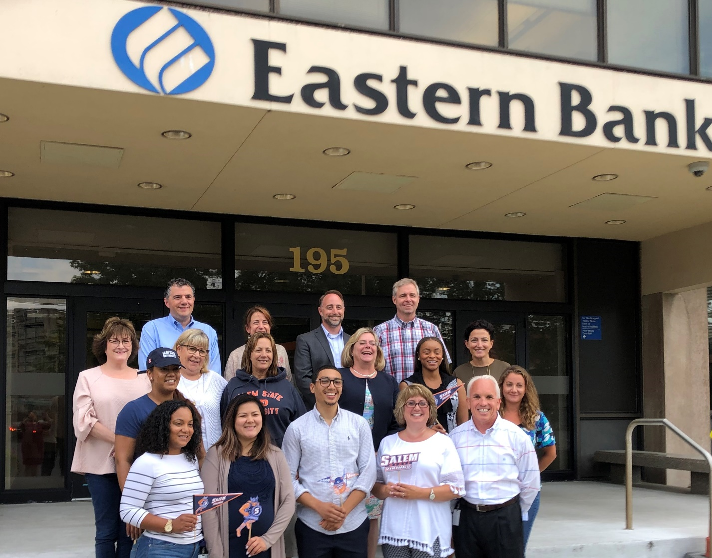 : A proud group of Eastern Bank employees who are Salem State students and alum…